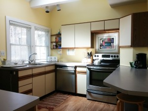 Bright Fully furnished kitchen with dishwasher, stainless range, refrigerator with ice maker, disposal, microwave, coffee maker.
